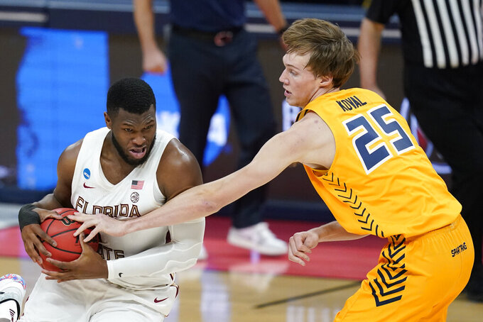 Florida State's RaiQuan Gray (1) is defended by UNC-Greensboro's Hayden Koval (25) during the first half of a first-round game in the NCAA men's college basketball tournament at Banker's Life Fieldhouse, Saturday, March 20, 2021, in Indianapolis. (AP Photo/Darron Cummings)