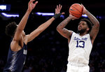 Seton Hall guard Myles Powell (13) shoots against Georgetown guard Jamorko Pickett during the first half of an NCAA college basketball game in the Big East men's tournament, Thursday, March 14, 2019, in New York. (AP Photo/Julio Cortez)