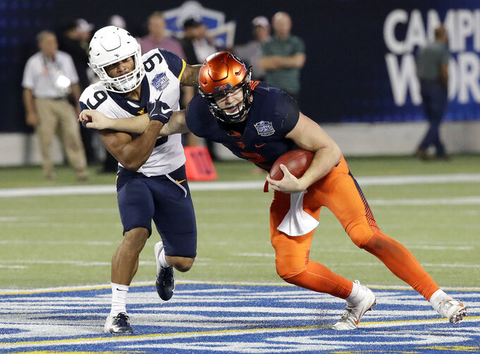 Syracuse quarterback Eric Dungey, right, tries to get past West Virginia safety Jovanni Stewart (9) as he scrambles for yardage during the second half of the Camping World Bowl NCAA college football game Friday, Dec. 28, 2018, in Orlando, Fla. (AP Photo/John Raoux)