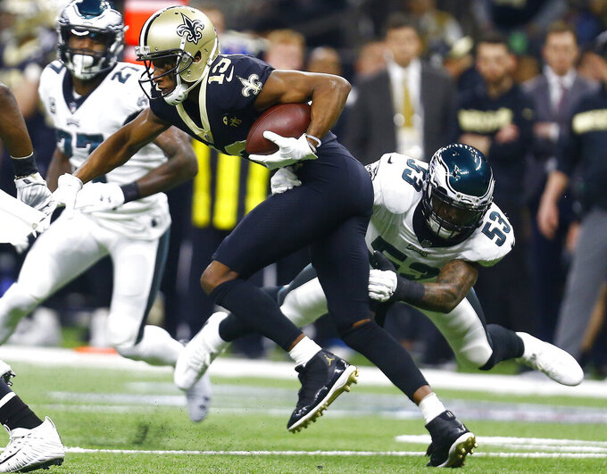 New Orleans Saints wide receiver Michael Thomas (13) runs against Philadelphia Eagles outside linebacker Nigel Bradham (53) in the first half of an NFL divisional playoff football game in New Orleans, Sunday, Jan. 13, 2019. (AP Photo/Butch Dill)