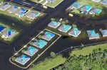 Water surrounds houses with tarps in the aftermath of Hurricane Delta, Saturday Oct. 10, 2020, in Iowa, La. (Bill Feig/The Advocate via AP, Pool)