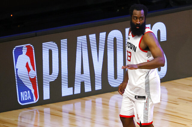 Houston Rockets' James Harden leaves the court following his team's loss during overtime against the Oklahoma City Thunder in Game 3 of an NBA basketball first-round playoff series, Saturday, Aug. 22, 2020, in Lake Buena Vista, Fla. (Mike Ehrmann/Pool Photo via AP)