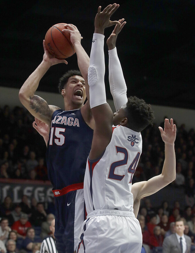 Gonzaga forward Brandon Clarke (15) shoots against Saint Mary's forward Malik Fitts (24) during the first half of an NCAA college basketball game in Moraga, Calif., Saturday, March 2, 2019. (AP Photo/Jeff Chiu)