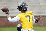 Missouri quarterback Kelly Bryant throws during an NCAA college football practice Monday, Aug. 12, 2019, in Columbia, Mo. (AP Photo/Jeff Roberson)