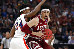Auburn forward Anfernee McLemore (24) defends against New Mexico State forward Eli Chuha, in the first half during a first round men's college basketball game in the NCAA Tournament Thursday, March 21, 2019, in Salt Lake City. (AP Photo/Jeff Swinger)