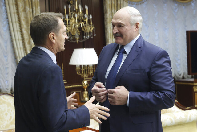 Belarusian President Alexander Lukashenko, right, talks with Sergei Naryshkin, head of the Russian Foreign Intelligence Service, during their meeting in Minsk, Belarus, Thursday, Oct. 22, 2020.  Lukashenko thanked Naryshkin for sharing intelligence information with Belarus. (Nikolai Petrov/BelTA Pool Photo via AP)