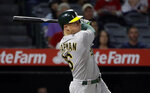 Oakland Athletics' Matt Chapman watches his two-run home run during the ninth inning of the team's baseball game against the Los Angeles Angels on Wednesday, Sept. 25, 2019, in Anaheim, Calif. (AP Photo/Marcio Jose Sanchez)