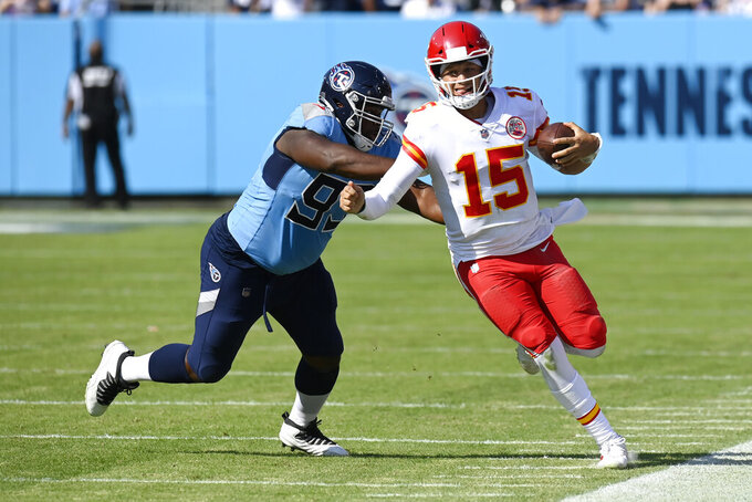 Kansas City Chiefs quarterback Patrick Mahomes (15) is pushed out of bounds by Tennessee Titans defensive tackle Teair Tart (93) in the second half of an NFL football game Sunday, Oct. 24, 2021, in Nashville, Tenn. (AP Photo/Mark Zaleski)