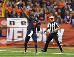 Syracuse running back Dontae Strickland (4) throws a pass to wide receiver Jamal Custis during the first half of an NCAA college football game against North Carolina State in Syracuse, N.Y., Saturday, Oct. 27, 2018. (AP Photo/Adrian Kraus)