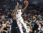 St. John's guard Mustapha Heron (14) goes to the basket against DePaul forward Femi Olujobi (25) in the second half of an NCAA college basketball game, Saturday, Jan. 12, 2019, in New York. DePaul won 79-71. (AP Photo/Mary Altaffer)