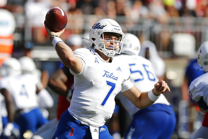 Tulsa quarterback Davis Brin drops back to pass against Ohio State during the first half of an NCAA college football game Saturday, Sept. 18, 2021, in Columbus, Ohio. (AP Photo/Jay LaPrete)