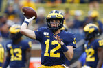 FILE - In this Aug. 31, 2019, file photo, Michigan quarterback Cade McNamara throws during warmups before an NCAA college football game against Middle Tennessee in Ann Arbor, Mich. McNamara is expected to start at quarterback this season for the Wolverines. (AP Photo/Paul Sancya, File)