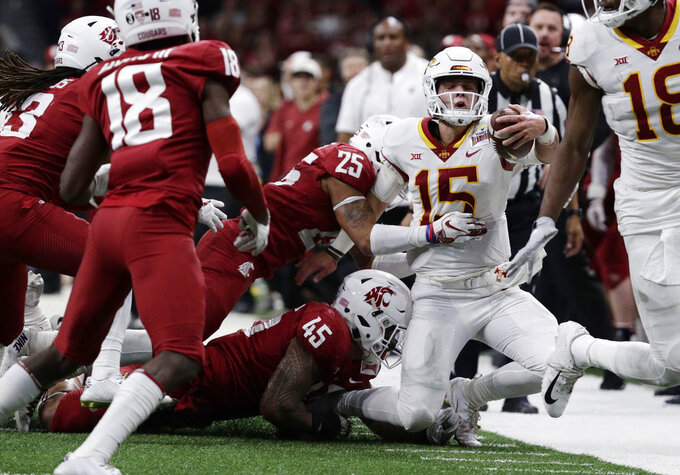 Iowa State quarterback Brock Purdy (15) is stopped short of a first down by Washington State defenders Skyler Thomas (25) and Logan Tago (45) during the second half of the Alamo Bowl NCAA college football game Friday, Dec. 28, 2018, in San Antonio. (AP Photo/Eric Gay)
