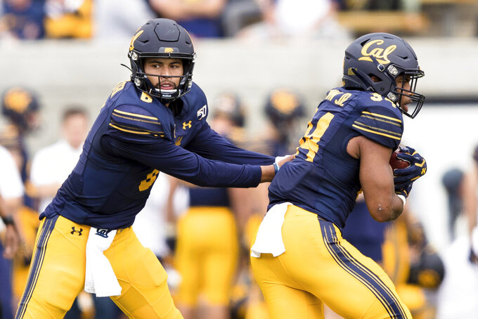 California quarterback Devon Modster, left, hands off to running back Christopher Brown Jr. in the first quarter of an NCAA college football game in Berkeley, Calif., Saturday, October 19, 2019. (AP Photo/John Hefti)