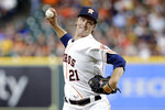 Houston Astros starting pitcher Zack Greinke (21) throws against the Cleveland Indians during the first inning of a baseball game Monday, July 19, 2021, in Houston. (AP Photo/Michael Wyke)