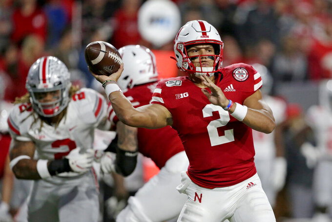 FILE - In this Sept. 28, 2019, file photo, Nebraska quarterback Adrian Martinez (2) throws a pass during the first half of an NCAA college football game against Ohio State, in Lincoln, Neb. Adrian Martinez will be a rare four-year starting quarterback at Nebraska this fall and yet, for all his experience, he's one of the team's biggest mysteries. (AP Photo/Nati Harnik, File)