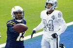 Los Angeles Chargers wide receiver Keenan Allen, left, scores a touchdown during the first half of an NFL football game against the Las Vegas Raiders, Sunday, Nov. 8, 2020, in Inglewood, Calif. (AP Photo/Alex Gallardo)
