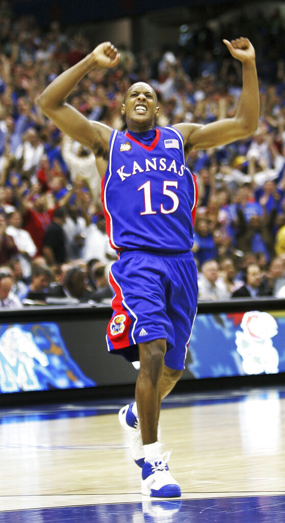 FILE - In this April 7, 2008, file photo, Kansas' Mario Chalmers (15) celebrates after hitting a three point shot to take the game into overtime against Memphis during the championship game at the NCAA college basketball Final Four in San Antonio. Chalmers 3-pointer with 2.1 seconds left in regulation pushed the game into overtime, and the Jayhawks grinded it out from there for a 75-68 victory over Memphis in one of the best title games in recent memory. (AP Photo/Eric Gay), File