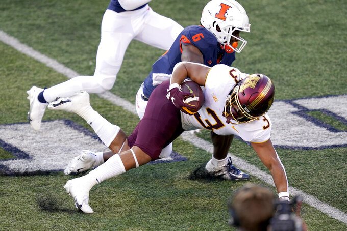 Minnesota running back Treyson Potts (3) is tackled by Illinois defensive back Tony Adams during the first half of an NCAA college football game Saturday, Nov. 7, 2020, in Champaign, Ill. (AP Photo/Charles Rex Arbogast)