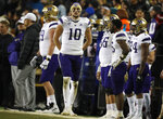 Washington quarterback Jacob Eason walks the sideline while looking at the scoreboard near the end of the team's NCAA college football game against Colorado on Saturday, Nov. 23, 2019, in Boulder, Colo. Colorado won 20-14. (AP Photo/David Zalubowski)