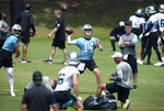 Carolina Panthers quarterback Sam Darnold, center, passes to a receiver during the team's NFL football practice on Tuesday, May 25, 2021 in Charlotte, N.C. (Jeff SIner/The Charlotte Observer via AP)