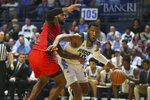 Rhode Island's Cyril Langevine (10) drives to the basket against the defense of Dayton's Trey Landers (3) of an NCAA college basketball game Wednesday, March 4, 2020, in Kingston, R.I. (AP Photo/Stew Milne)