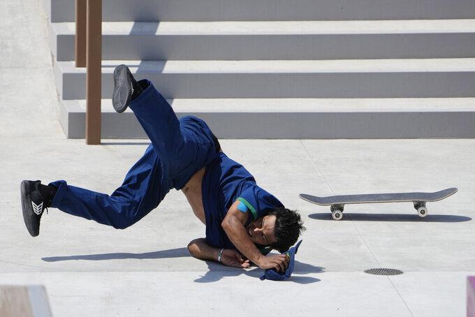 Kelvin Hoefler of Brazil tumbles during the men's street skateboarding finals at the 2020 Summer Olympics, Sunday, July 25, 2021, in Tokyo, Japan. (AP Photo/Jae C. Hong)