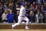 Chicago Cubs' Javier Baez watches his game winning RBI-single against the Philadelphia Phillies during the ninth inning of a baseball game, Tuesday, May 21, 2019, in Chicago. (AP Photo/Kamil Krzaczynski)