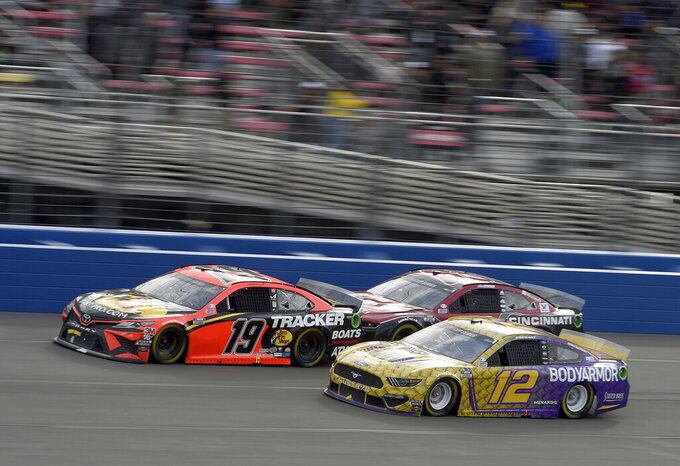 Martin Truex Jr. (19) leads Alex Bowman (88) and Ryan Blaney (12) on lap 130 of a NASCAR Cup Series auto race Sunday, March 1, 2020 in Fontana, Calif. (AP Photo/Will Lester)