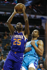 Phoenix Suns forward Mikal Bridges, left, shoots against Charlotte Hornets forward Miles Bridges (0) in the first half of an NBA basketball game in Charlotte, N.C., Monday, Dec. 2, 2019. (AP Photo/Nell Redmond)