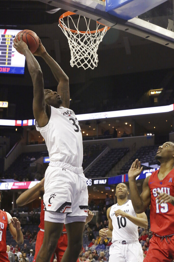 Cincinnati's Nyster Brooks goes up for a dunk over teammate Rashawn Fredericks and SMU's Isiaha Mike during the first half of an NCAA college basketball game at the American Athletic Conference men's tournament Friday, March 15, 2019, in Memphis, Tenn. (AP Photo/Troy Glasgow)
