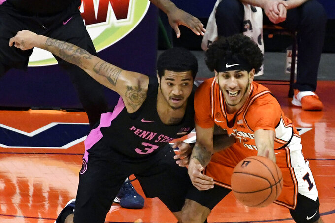 Illinois guard Andre Curbelo, right, battles for a rebound with Penn State's guard Sam Sessoms (3) during the first half of an NCAA college basketball game Tuesday, Jan. 19, 2021, in Champaign, Ill. (AP Photo/Holly Hart)