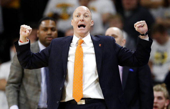 FILE - In this Feb. 18, 2017, file photo, then-Illinois head coach John Groce directs his team during the second half of an NCAA college basketball game against Iowa, in Iowa City, Iowa. Akron coach John Groce has agreed to a contract extension through 2026. Zips athletic director Larry Williams announced the agreement on Tuesday, March 30, 2021 with Groce, who just completed his fourth season at the school. Groce is 70-49 overall since he wad hired in 2017. The Zips are 26-10 in the Mid-American Conference over the past two seasons.(AP Photo/Charlie Neibergall, File)
