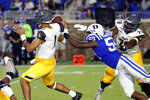 Duke's Tre Hornbuckle (59) strips the ball from North Carolina A&T's Jalen Fowler (1) during the second half of an NCAA college football game in Durham, N.C., Saturday, Sept. 7, 2019. (AP Photo/Karl B DeBlaker)