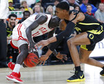 Utah's Both Gach, left, and Oregon's Kenny Wooten scramble for the ball during the first half of an NCAA college basketball game in the quarterfinals of the Pac-12 men's tournament Thursday, March 14, 2019, in Las Vegas. (AP Photo/John Locher)