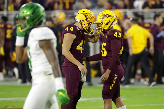 Arizona State's Christian Zendejas (45) celebrates his field goal with punter Kevin Macias (44) during the first half of an NCAA college football game against Oregon, Saturday, Nov. 23, 2019, in Tempe, Ariz. (AP Photo/Matt York)