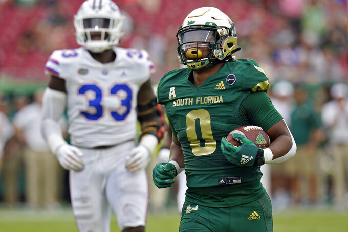 South Florida running back Jaren Mangham (0) scores on a 3-yard touchdown run against Florida during the second half of an NCAA college football game Saturday, Sept. 11, 2021, in Tampa, Fla. (AP Photo/Chris O'Meara)