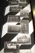 Photographs showing women's football teams are displayed at an exhibition about Lily Parr at the National Football Museum in Manchester, England, Thursday, July 29, 2021. Lily Parr, whose record-setting career was overlooked when the bosses of English soccer shunned the women's game, is now the focus of a new permanent exhibition at the National Football Museum in Manchester. (AP Photo/Jon Super)