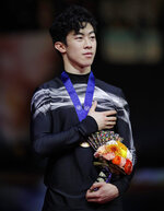 Nathan Chen from the U.S. stands for his national anthem after winning the gold medal for the men's free skating routine during the ISU World Figure Skating Championships at Saitama Super Arena in Saitama, north of Tokyo, Saturday, March 23, 2019. (AP Photo/Andy Wong)