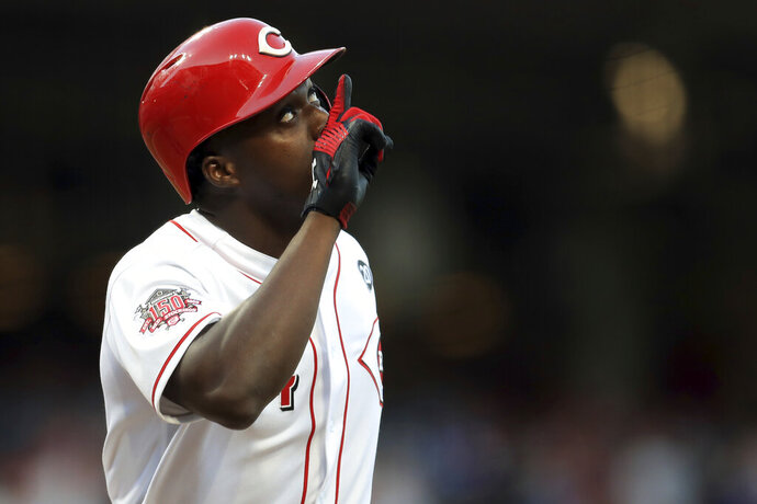 Cincinnati Reds' Aristides Aquino celebrates after hitting a solo home run, his second home run of the game, in the third inning of a baseball game against the Chicago Cubs, Saturday, Aug. 10, 2019, in Cincinnati. (AP Photo/Aaron Doster)