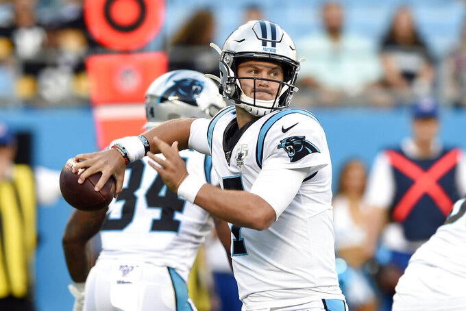 FILE - In this Aug. 29, 2019, file photo, Carolina Panthers quarterback Kyle Allen (7) passes against the Pittsburgh Steelers during the first half of an NFL preseason football game in Charlotte, N.C. With Cam Newton reaggravating his foot, the team is looking at the possibility of starting Kyle Allen on Sunday against Arizona, the first of four road games in the next five. Allen has just one career start. (AP Photo/Mike McCarn, File)