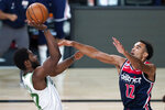 Boston Celtics' Semi Ojeleye, left, shoots as Washington Wizards' Jerome Robinson (12) defends during the second half of an NBA basketball game Thursday, Aug. 13, 2020 in Lake Buena Vista, Fla. (AP Photo/Ashley Landis, Pool)
