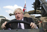 FILE - In this file photo dated Thursday, June 21, 2018, Britain's Foreign Secretary Boris Johnson talks during a ceremony at the Tomb of the Unknown Soldier in Warsaw, Poland. The chairman of Britain's governing Conservative Party Brandon Lewis on Tuesday Aug. 7, 2018, asked former Foreign Secretary Boris Johnson to apologize for a newspaper column written by Johnson, that said burqa-wearing women looked like