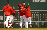 Boston Red Sox's Michael Chavis, second from right, is mobbed by teammates after his game-ending RBI single during the 10th inning of a baseball game against the Colorado Rockies on Wednesday, May 15, 2019, at Fenway Park in Boston. The Red Sox won 6-5.(AP Photo/Winslow Townson)