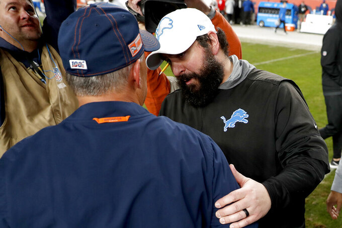 Detroit Lions head coach Matt Patricia, right, greets Denver Broncos head coach Vic Fangio after an NFL football game, Sunday, Dec. 22, 2019, in Denver. The Broncos won 27-17. (AP Photo/David Zalubowski)