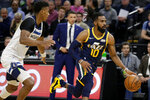 Utah Jazz guard Mike Conley (10) drives away from Minnesota Timberwolves guard Jarrett Culver during the first quarter of an NBA basketball game Wednesday, Nov. 20, 2019 in Minneapolis. (AP Photo/Andy Clayton- King)