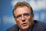 FILE - In this Feb. 18, 2014 file photo, Former FIFA Secretary General Jerome Valcke speaks during a news conference for the 2014 World Cup in Florianopolis, Brazil. Qatari soccer and television executive Nasser al-Khelaifi will go on trial starting Sept. 14, 2020 in Switzerland in September, implicated in providing a holiday villa to a FIFA official linked to a World Cup broadcasting deal. The court has listed 10 days in September to hear the case against al-Khelaifi, former top FIFA official Jerome Valcke and another broadcasting executive who was not identified. (AP Photo/Andre Penner, file)