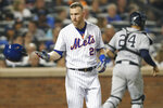 New York Mets' Todd Frazier (21) tosses his batting helmet after he struck out looking as New York Yankees catcher Gary Sanchez (24) heads to the dugout during the sixth inning of a baseball game Wednesday, July 3, 2019, in New York. (AP Photo/Kathy Willens)