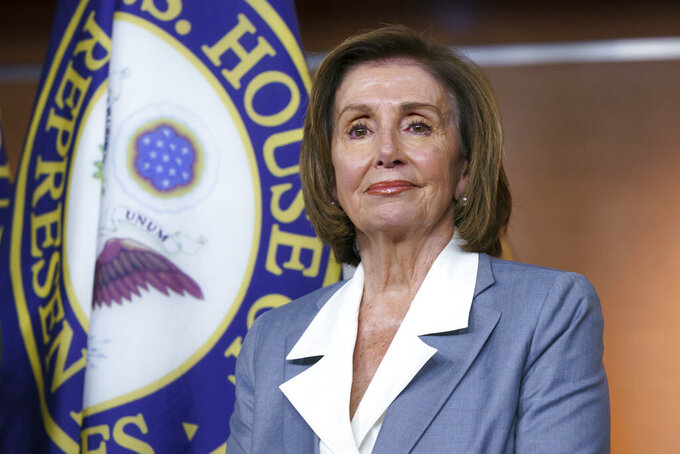 """FILE - In this June 30, 2021 file photo, Speaker of the House Nancy Pelosi, D-Calif., listens at a news conference as the House prepares to vote on the creation of a select committee to investigate the Jan. 6 insurrection, at the Capitol in Washington. Pelosi is rejecting two Republicans tapped by House GOP Leader Kevin McCarthy to sit on a committee investigating the Jan. 6 Capitol insurrection. She cited the """"integrity"""" of the investigation. Pelosi said in a statement Wednesday that she would not accept the appointments of Indiana Rep. Jim Banks, whom McCarthy picked to be the top Republican on the panel, or Ohio Rep. Jim Jordan. Both are close allies of former President Donald Trump.  (AP Photo/J. Scott Applewhite)"""