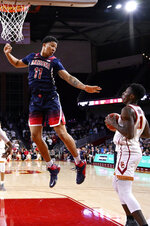 Southern California forward Onyeka Okongwu, right, tries to shoot as Arizona forward Ira Lee defends during the second half of an NCAA college basketball game Thursday, Feb. 27, 2020, in Los Angeles. USC won 57-48. (AP Photo/Mark J. Terrill)